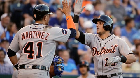 Detroit Tigers&#039 Mikie Mahtook right celebrates with Victor Martinez after hitting a two-run home run during the third inning of the team's baseball game against the Kansas City Royals on Monday