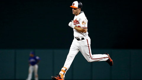 Baltimore Orioles' Seth Smith rounds the bases after hitting a solo home run during the seventh inning of the team's baseball game against the Texas Rangers in Baltimore, Monday, July 17, 2017. Baltimore won 3-1. (AP Photo/Patrick Semansky)