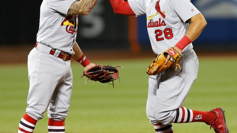 St. Louis Cardinals second baseman Kolten Wong celebrates with left fielder Tommy Pham (28) after the Cardinals defeated the New York Mets 6-3 in a baseball game Monday, July 17, 2017, in New York. (AP Photo/Kathy Willens)