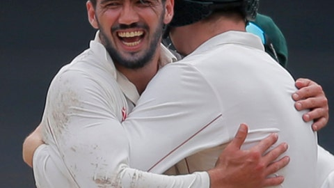 Zimbabwe's captain Graeme Cremer, left, celebrates the dismissal of Sri Lanka's Angelo Mathews with a teammate on the final day of their only test cricket match in Colombo, Sri Lanka, Tuesday, July 18, 2017. (AP Photo/Eranga Jayawardena)