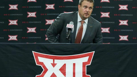 Texas head football coach Tom Herman takes a seat on the dais before speaking to reporters during the Big 12 NCAA college football media day in Frisco, Texas, Tuesday, July 18, 2017. (AP Photo/LM Otero)