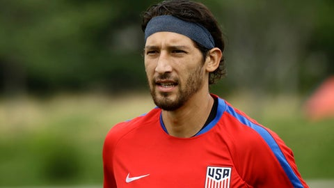 United States' Omar Gonzalez moves across the field to speak with members of the media at the University of Pennsylvania in Philadelphia, Tuesday, July 18, 2017. Gonzalez's career has revived since he transferred two years ago from the LA Galaxy to Pachuca, where he was introduced in a Darth Vader costume, and the 6-foot-5 defender has become a regular part of the player pool for the United States, which plays El Salvador on Wednesday in a CONCACAF Gold Cup soccer quarterfinal. (AP Photo/Matt Rourke)