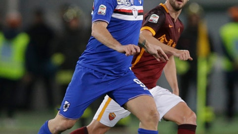 FILE - In this Sunday, Feb. 7, 2016 file photo, Sampdoria's Antonio Cassano, left, is chased by Roma's Miralem Pjanic during a Serie A soccer match Rome's Olympic stadium. Temperamental former Italy forward Antonio Cassano has decided to continue playing football _ hours after telling friends and family he was going to retire. After being dropped by Sampdoria and failing to play a single match last season, the 35-year-old Cassano signed with promoted Hellas Verona earlier this month. (AP Photo/Alessandra Tarantino, File)