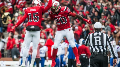 FILE - In this Dec. 3, 2016, file photo, Western Kentucky Hilltoppers wide receiver Nicholas Norris (15) and Anthony Wales (20) celebrate a touchdown during Western Kentucky's 58-44 win over Louisiana Tech, at Houchens-Smith Stadium in Bowling Green, Ky. Five years as Western Kentucky's athletic director has yielded more success and trophies than Todd Stewart could have expected. The Hilltoppers have won 33 titles in 12 sports between two leagues over that span, including seven this past year in C-USA.  (Austin Anthony/Daily News via AP, File)