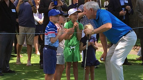 Hale Irwin speaks with children before teeing off on the fourth hole at The Broadmoor's East Golf Course on Tuesday, July 18, 2017 in Colorado Springs, Colo. Irwin's tee shot capped the launch party for the 2018 U.S. Senior Open, where  Denver Broncos general manager John Elway will serve as honorary chairman. (AP Photo/Arnie Stapleton).