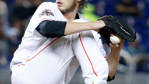 Miami Marlins' Adam Conley delivers a pitch during the first inning of a baseball game against the Philadelphia Phillies, Tuesday, July 18, 2017, in Miami. (AP Photo/Wilfredo Lee)