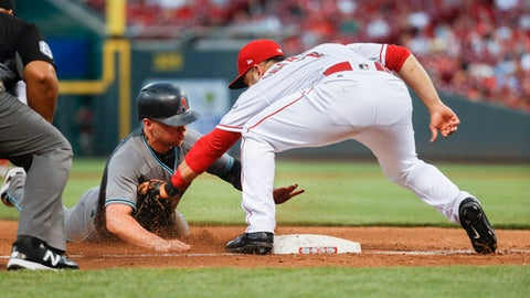 Arizona Diamondbacks' Brandon Drury, left, is caught stealing third by Cincinnati Reds third baseman Eugenio Suarez, right, during the fifth inning of a baseball game, Tuesday, July 18, 2017, in Cincinnati. (AP Photo/John Minchillo)