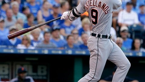 Detroit Tigers' Nicholas Castellanos watches his two-run triple during the second inning of the team's baseball game against the Kansas City Royals on Tuesday, July 18, 2017, in Kansas City, Mo. (AP Photo/Charlie Riedel)