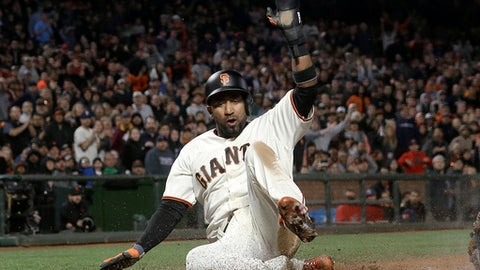 San Francisco Giants' Eduardo Nunez scores against the Cleveland Indians during the sixth inning of a baseball game in San Francisco, Tuesday, July 18, 2017. (AP Photo/Jeff Chiu)