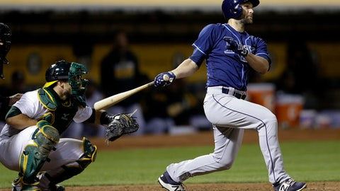 Tampa Bay Rays' Shane Peterson watches his RBI single off Oakland Athletics' Santiago Casilla during the ninth inning of a baseball game Tuesday, July 18, 2017, in Oakland, Calif. (AP Photo/Ben Margot)