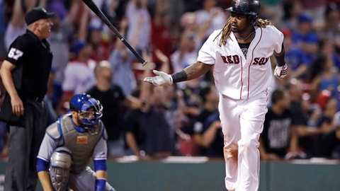 Boston Red Sox's Hanley Ramirez flips his bat after his game-winning solo home run during the 15th inning of the team's baseball game against the Toronto Blue Jays at Fenway Park in Boston, early Wednesday, July 19, 2017. The Red Sox won 5-4. (AP Photo/Charles Krupa)