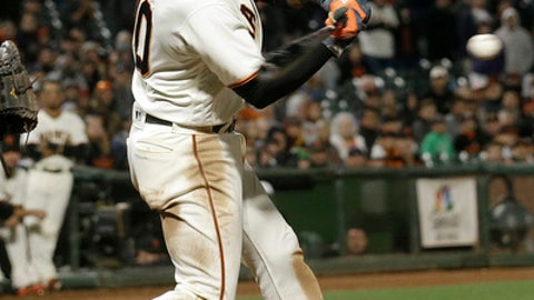 San Francisco Giants' Eduardo Nunez singles to drive in the winning run during the 10th inning against the Cleveland Indians in a baseball game in San Francisco, Tuesday, July 18, 2017. The Giants won 2-1. (AP Photo/Jeff Chiu)