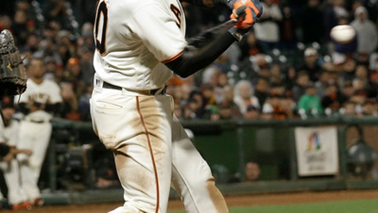 Giants rock Pirates to help Bumgarner earn first win