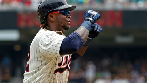 Minnesota Twins Miguel Sano celebrates his three-run home run against the New York Yankees in the second inning of a baseball game Wednesday, July 19, 2017, in Minneapolis. (AP Photo/Bruce Kluckhohn)