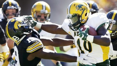 North Dakota State running back Lance Dunn, right, breaks a tackle by Iowa defensive back Miles Taylor, left, during the second half of an NCAA college football game, Saturday, Sept. 17, 2016, in Iowa City, Iowa. North Dakota State won 23-21. (AP Photo/Charlie Neibergall)