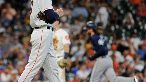 Houston Astros starting pitcher Charlie Morton, left, walks off the mound as Seattle Mariners' Ben Gamel, right, rounds the bases after hitting a two-run home run during the fourth inning of a baseball game, Wednesday, July 19, 2017, in Houston. (AP Photo/Eric Christian Smith)