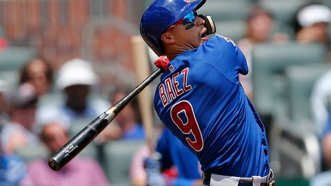 Chicago Cubs second baseman Javier Baez (9) watches the flight of the ball as he follows through on three-run home run in the eighth inning of a baseball game against the Atlanta Braves Wednesday, July 19, 2017, in Atlanta. Chicago won 8-2. (AP Photo/John Bazemore)