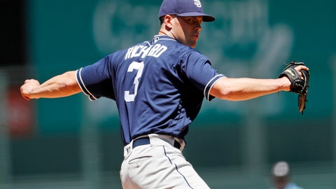 San Diego Padres starter Clayton Richard delivers a pitch to Colorado Rockies' Nolan Arenado in the first inning of a baseball game Wednesday, July 19, 2017, in Denver. (AP Photo/David Zalubowski)