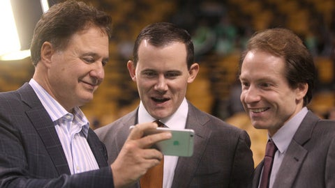 BOSTON - NOVEMBER 17: Before game time, Suns general manager Ryan McDonough, center, chats with Celtics co-owner Steve Pagliuca, left, and Sean Grande, the voice of the Celtics. Pagliuca shares video of his son's Saturday Duke game against Fairfield. The Boston Celtics host the Phoenix Suns, at the TD Garden, on Monday, November 17, 2014. (Photo by Pat Greenhouse/The Boston Globe via Getty Images)