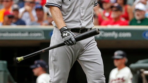 New York Yankees Todd Frazier returns to the dugout after striking out to the Minnesota Twins in the seventh inning of a baseball game Wednesday, July 19, 2017, in Minneapolis. (AP Photo/Bruce Kluckhohn)