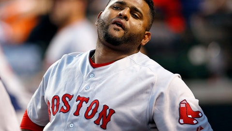 FILE - In this Sept. 14, 2015, file photo, Boston Red Sox's Pablo Sandoval stands in the dugout during a baseball game against the Baltimore Orioles i Baltimore. The Red Sox on Wednesday, July 19, 2017, have released Sandoval because the third baseman didn't report after being designated for assignment last week. It officially ends the Boston tenure for the once-celebrated free agent, who never was healthy enough to live up to the expectations that came with the $95 million contract he signed in 2014.  (AP Photo/Patrick Semansky, File)