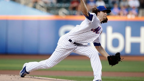 New York Mets' Jacob deGrom delivers a pitch during the first inning of the team's baseball game against the St. Louis Cardinals on Wednesday, July 19, 2017, in New York. (AP Photo/Frank Franklin II)