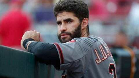 Arizona Diamondbacks right fielder J.D. Martinez stands in the dugout in the first inning of a baseball game against the Cincinnati Reds, Wednesday, July 19, 2017, in Cincinnati. (AP Photo/John Minchillo)