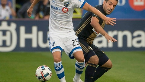 Montreal Impact's Louis Beland-Goyette (25) gets away from Philadelphia Union's Haris Medunjanin during the first half of an MLS soccer match Wednesday, July 19, 2017, in Montreal. (Peter McCabe/The Canadian Press via AP)