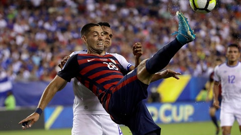 United States' Clint Dempsey (28) is defended by El Salvador's Henry Romero (4) during a CONCACAF Gold Cup quarterfinal soccer match in Philadelphia, Wednesday, July 19, 2017. (AP Photo/Matt Rourke)
