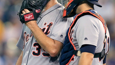 Detroit Tigers starting pitcher Justin Verlander, left, talks with catcher Alex Avila during the sixth inning of the team's baseball game against the Kansas City Royals at Kauffman Stadium in Kansas City, Mo., Wednesday, July 19, 2017. (AP Photo/Orlin Wagner)
