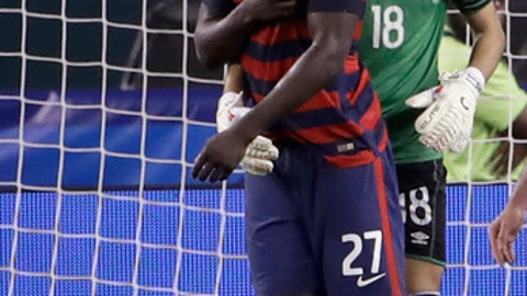 El Salvador's Derby Carrillo (18) holds Unites States' Jozy Altidore (27) as he reacts to an incident with El Salvador's Henry Romero, lying on the ground, during a CONCACAF Gold Cup quarterfinal soccer match in Philadelphia, Wednesday, July 19, 2017. Romero appeared to first bite Altidore on the back of a shoulder and then pull the American forward's nipple. Canadian referee Drew Fischer, a Major League Soccer regular, did not penalize the incident. (AP Photo/Matt Rourke)