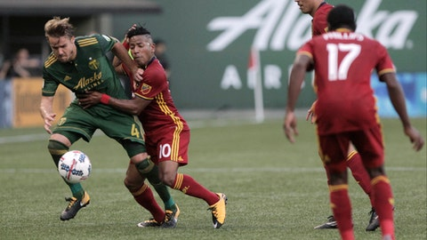 Real Salt Lake's Joao Plata (10) and Portland Timbers' Chance Myers (4) vie for the ball during an MLS soccer match Wednesday, July 19, 2017, in Portland, Ore. (Sean Meagher/The Oregonian via AP)