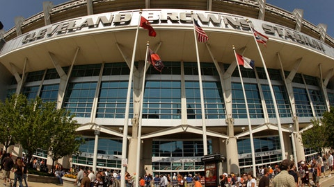 "FILE-In this Sunday, Sept. 13, 2009 file photo, fans walk into Cleveland Browns Stadium before the Minnesota Vikings play the Cleveland Browns in an NFL football game, in Cleveland. In sales brochures, a U.S. company boasted of the ""stunning visual effect"" its shimmering aluminum panels created in an NFL stadium, an Alaskan school and a 33-story hotel on Baltimore's waterfront.(AP Photo/Tony Dejak, File)"