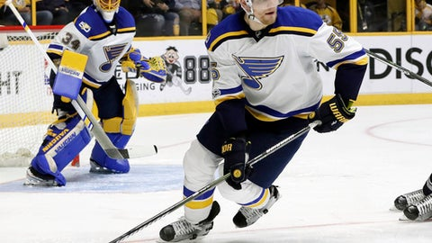 FILE - In this May 2, 2017, file photo, St. Louis Blues defenseman Colton Parayko, center, moves the puck during the second period in Game 4 of a second-round NHL hockey playoff series against Nashville, in Nashville, Tenn. The St. Louis Blues and defenseman Colton Parayko agreed to a $27.5 million, five-year contract just before the sides were set to go to arbitration. General manager Doug Armstrong confirmed the deal Thursday, July 20, 2017. (AP Photo/Mark Humphrey, File)