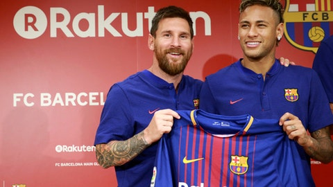 "FILE - In this July 13, 2017, file photo, FC Barcelona's Lionel Messi, left, and Neymar pose with their new jersey during a press conference in Tokyo.   Neymar is not for sale, according to Barcelona President Josep Bartomeu. Speaking Thursday, July 20, 2017 during an interview at The Associated Press, Bartomeu said: ""He is not on the market."" (AP Photo/Eugene Hoshiko, File)"