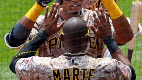 Pittsburgh Pirates' Gregory Polanco celebrates with Starling Marte (6) after hitting a solo home run off Milwaukee Brewers starting pitcher Jimmy Nelson in the fourth inning of a baseball game in Pittsburgh, Thursday, July 20, 2017. (AP Photo/Gene J. Puskar)