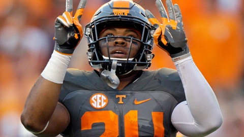"""FILE - In this Sept. 24, 2016, file photo, Tennessee defensive back Todd Kelly Jr. (24) gestures after an interception during the second half of an NCAA college football game against Florida, in Knoxville, Tenn. Tennessee doesn't mind adopting an underdog mentality a year after the Volunteers failed to meet preseason expectations. """"Right now we're in the weeds,"""" senior safety Todd Kelly Jr. said. """"No one's really seeing us, almost like a snake in the grass. Our goal is to end up biting somebody at the end of the day and making them pay."""" (AP Photo/Wade Payne, File)"""