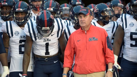 FILE - In this Oct. 3, 2015, file photo, Mississippi coach Hugh Freeze waits to take the field before the team's NCAA college football game against Florida in Gainesville, Fla. Freeze has resigned after five seasons, bringing a stunning end to a once-promising tenure. The school confirmed Freeze's resignation in a release Thursday night. Assistant Matt Luke has been named the interim coach. (AP Photo/Phelan M. Ebenhack, File)