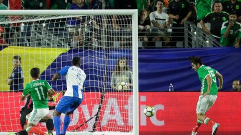 Mexico's Rodolfo Pizarro, right, strikes the ball to score against Honduras during a CONCACAF Gold Cup quarterfinal soccer match, Thursday, July 20, 2017, in Glendale, Ariz. (AP Photo/Matt York)