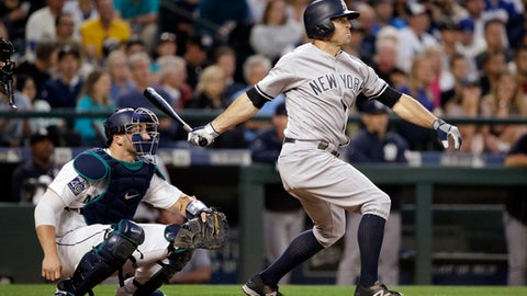 New York Yankees' Brett Gardner, right, and Seattle Mariners catcher Mike Zunino watch Gardner's home run during the sixth inning of a baseball game Thursday, July 20, 2017, in Seattle. (AP Photo/Elaine Thompson)