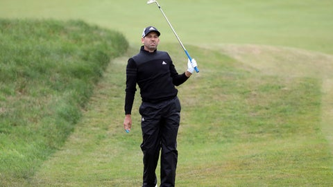 Spain's Sergio Garcia watches his shot on the 2nd fairway during the second round of the British Open Golf Championship, at Royal Birkdale, Southport, England Friday, July 21, 2017. (AP Photo/Peter Morrison)