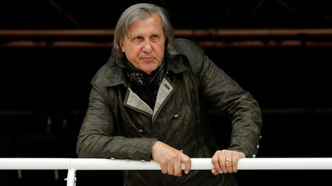 FILE - In this Monday, May 23, 2016 file picture, former Romanian tennis ace Ilie Nastase watches a match of the French Open tennis tournament at the Roland Garros stadium, in Paris, France.  Ilie Nasatse  on Friday July 21, 2017 has been banned from the Fed Cup and Davis Cup until 2019 because of his foul-mouthed comments and bad behavior as Romania's captain during a Fed Cup match against Britain. The International Tennis Federation also said the 1973 French Open champion will not be able to work in an official capacity for a further two years. (AP Photo/Alastair Grant, File)