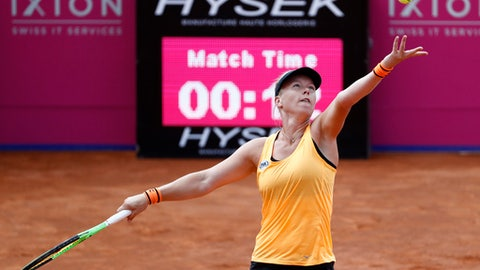 Kiki Bertens of the Netherlands serves a ball during her quarterfinal match against Johanna Larsson of Sweden, at the WTA Ladies Championship tennis tournament in Gstaad, Switzerland,  Friday, July 21, 2017. (Peter Klaunzer/Keystone via AP)