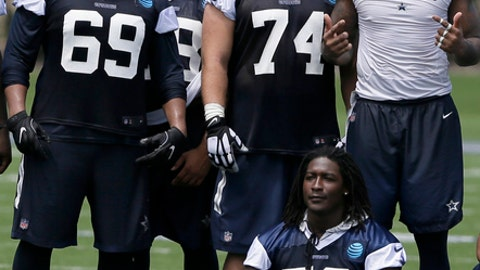 FILE - In this June 15, 2017, file photo, standing from left to right, Dallas Cowboys defensive linemen Jordan Carrell (69), Woody Baron, Joey Ivie (74) and Darnell Leslie as Lenny Jones (56) sits while they pose for photos after an NFL football practice at the team's training facility, in Frisco, Texas. Dallas rookie defensive tackle Joey Ivie faces long odds making the Cowboys roster. The former Florida standout feels the presence of a partner in that pursuit: his late sister, Jordan Ivie. She's been his inspiration since she died in a car crash two years ago. (AP Photo/Jaime Dunaway, File)