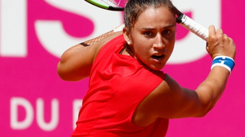 Sara Sorribes Tormo of Spain returns a shot during her quarter final match against Tamara Korpatsch of Germany, at the WTA Ladies Championship tennis tournament in Gstaad, Switzerland, Friday, July 21, 2017. (Peter Klaunzer/Keystone via AP)