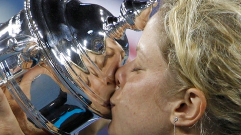 FILE - In this Sept. 11, 2010, file photo, Kim Clijsters, of Belgium, kisses the championship trophy after winning the finals at the U.S. Open tennis tournament in New York. Clijsters will be inducted into the International Tennis Hall of Fame on Saturday, July 22, 2017.(AP Photo/Mark Humphrey, File)