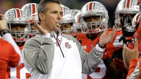FILE - In this Jan. 12, 2015, file photo, Ohio State head coach Urban Meyer rallies his players before the NCAA college football playoff championship game against Oregon in Arlington, Texas. The AP reported on July 21, 2017, that a story claiming Meyer had resigned from Ohio State is a hoax. (AP Photo/Eric Gay, File)