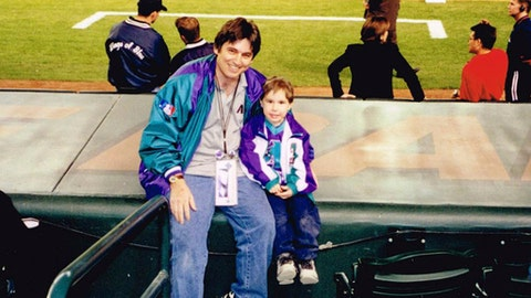 In this 1998 photo provided by Frank Gennario Jr., Frank Gennario Jr. and his son, Tony, pose at Bank One Ballpark in Phoenix, Ariz. Frank Gennario lost his father to bone cancer when he was 16, and he clings tightly to memories of their days at Yankee Stadium. When Frank's only son was nearing the same age, it became critical to him that they build those same ballpark memories. So the pair set a goal: see their beloved Arizona Diamondbacks play in every big league park. Ten years later, they have completed their quest. (Frank Gennario Jr. via AP)