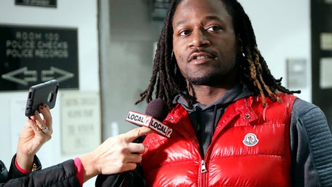 """FILE - In this Jan. 4, 2017, file photo, Cincinnati Bengals NFL football player Adam """"Pacman"""" Jones speaks to reporters as he is released from the Hamilton County Justice Center in Cincinnati. Jones faces three misdemeanor charges, including assault, but no longer is charged with a felony for a January confrontation, Hamilton County Prosecutor Joe Deters  announced Wednesday, March 22, 2017.  The felony charge of harassment with a bodily substance was dismissed at the prosecuting attorney's request.  Deters says the misdemeanors also include disorderly conduct and obstructing official business. (AP Photo/John Minchillo, File)"""