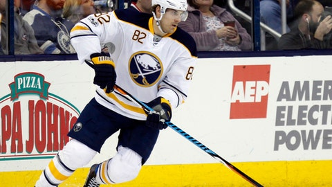 FILE - In this March 28, 2017, file photo, Buffalo Sabres forward Marcus Foligno carries the puck against the Columbus Blue Jackets during an NHL hockey game in Columbus, Ohio. Marcus Foligno has left the leap behind in Buffalo. That doesn't mean his offensive production can't or won't continue to rise in Minnesota. Coming off a career-high 13 goals for the Sabres last season, the soon-to-be-26-year-old was acquired in a trade earlier this summer to bring some needed grit and strength to the left wing position. (AP Photo/Paul Vernon, File)